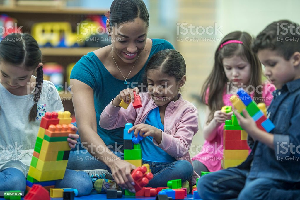 Teacher Playing with Her Students stock photo