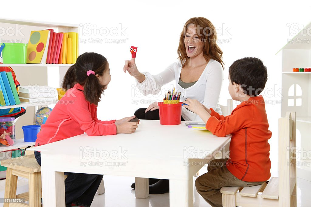 Teacher playing with kids royalty-free stock photo