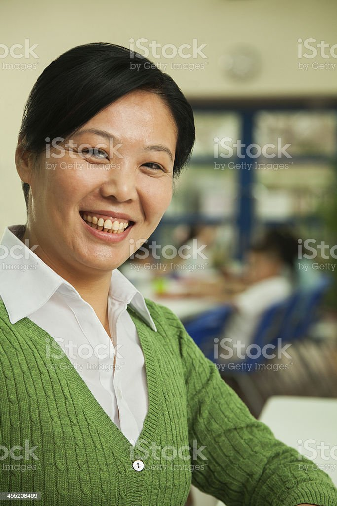 Teacher portrait at lunch in school cafeteria stock photo