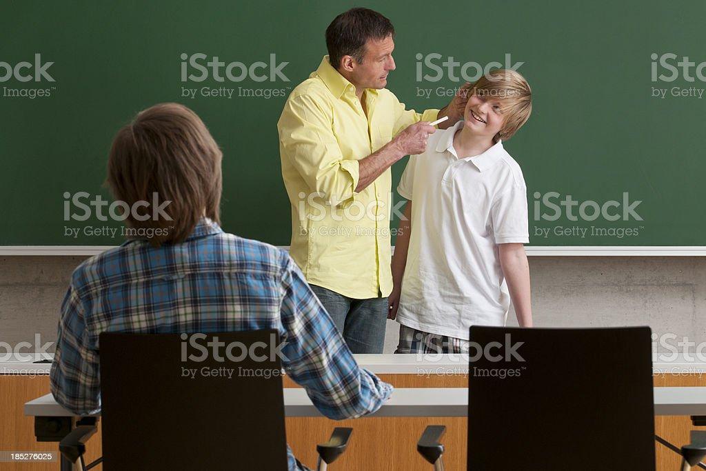 teacher punishing pupil royalty-free stock photo