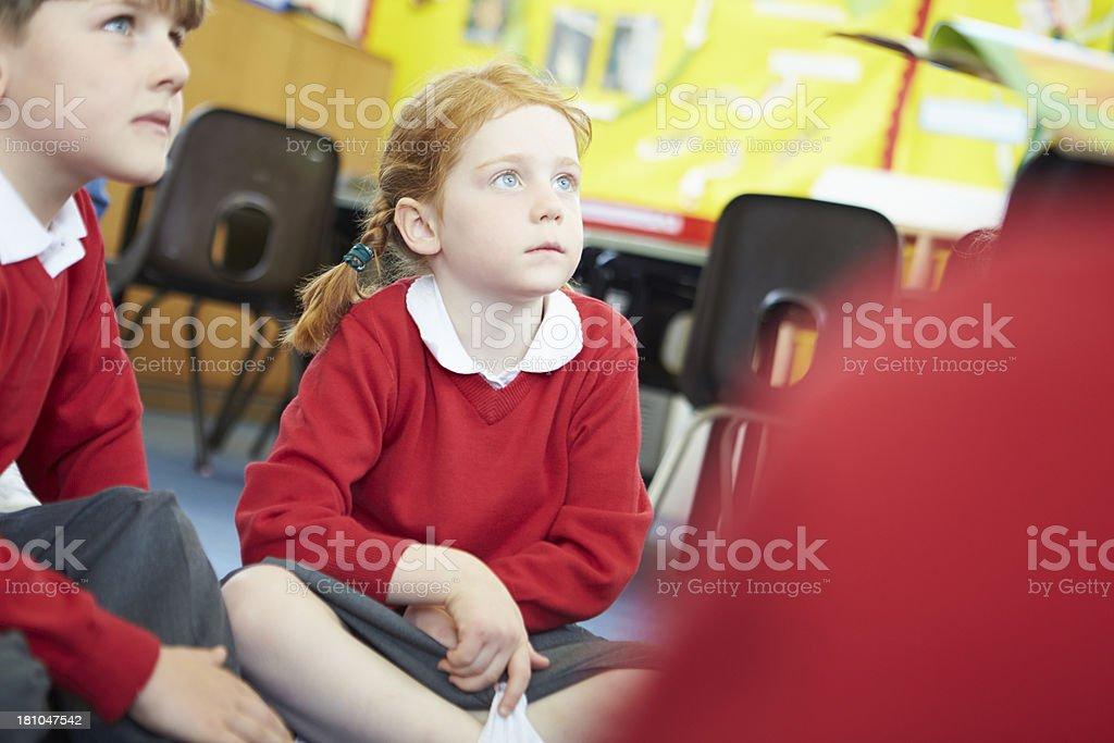 Teacher Reading Story To Elementary School Pupils royalty-free stock photo