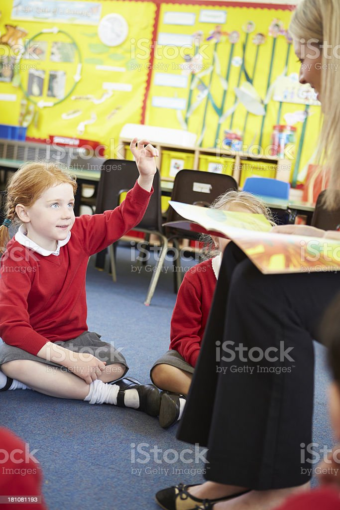 Teacher Reading Story To Elementary School Pupils royalty-free stock photo
