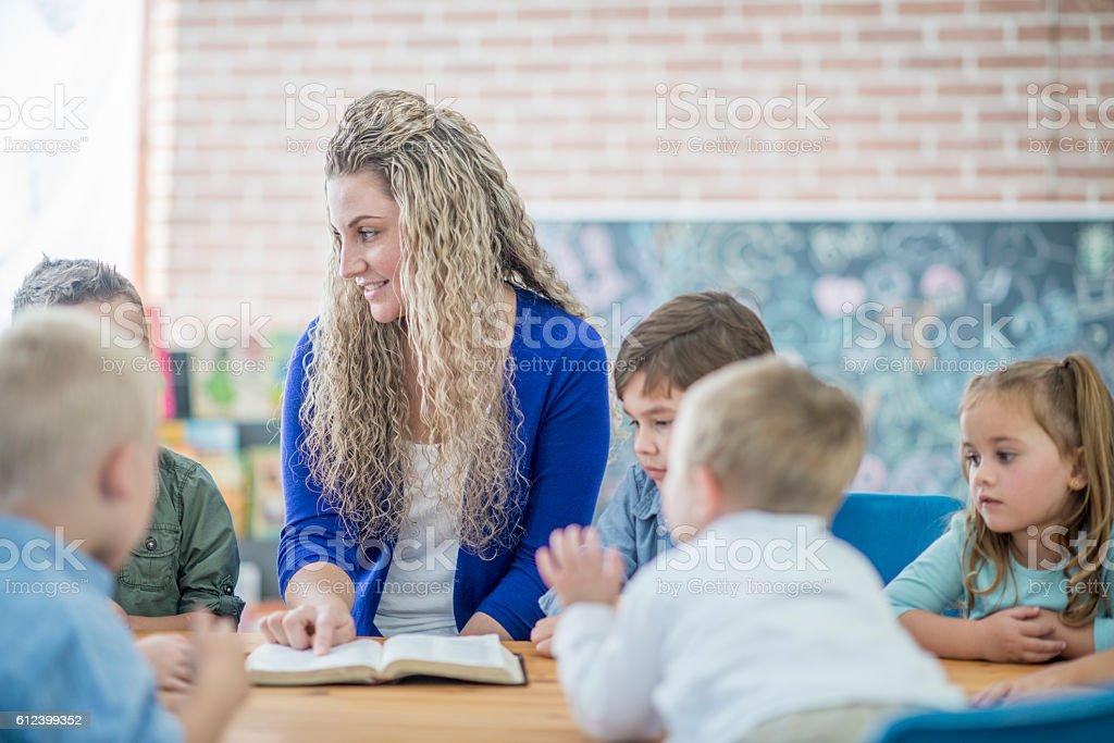 Teacher Reading the Bible stock photo