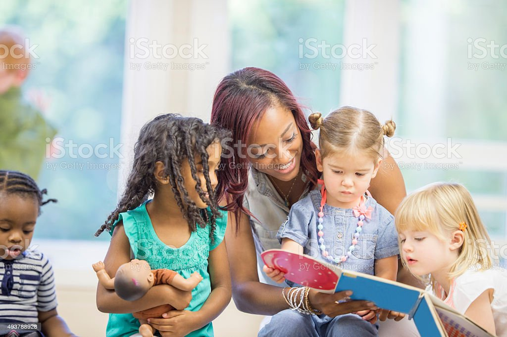 Teacher Reading the Children a Picture Book stock photo