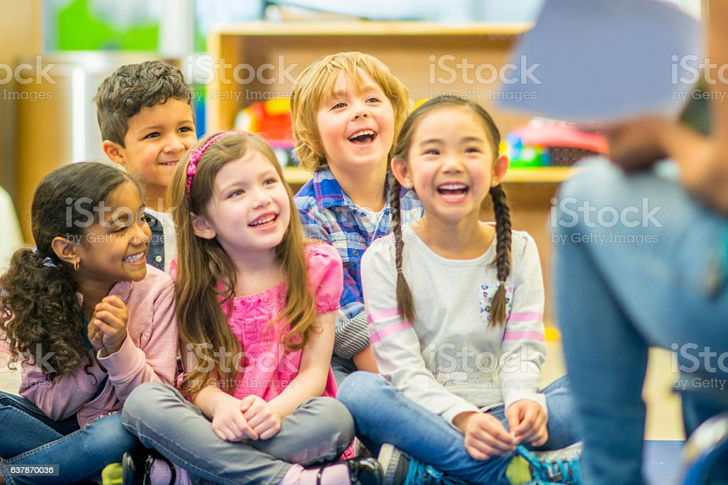 Teacher Reading to Her Students stock photo