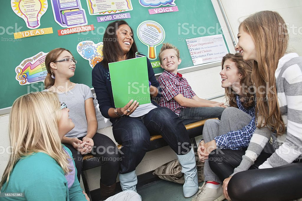 Teacher Reading to Students in Classroom royalty-free stock photo