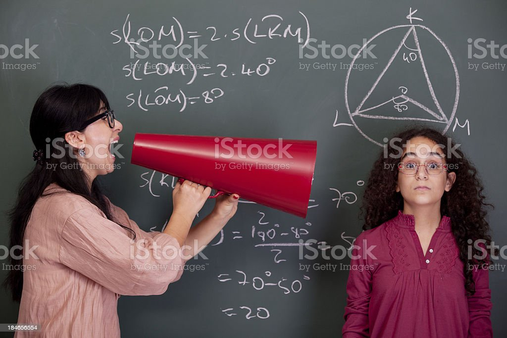 Teacher shouting at cool nerd student for mathmatics royalty-free stock photo