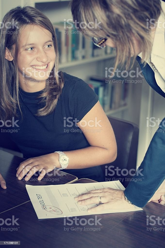 Teacher showing an excellent exam to a student royalty-free stock photo