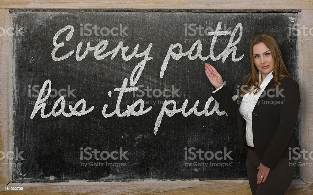 Teacher showing Every path has its puddle on blackboard stock photo