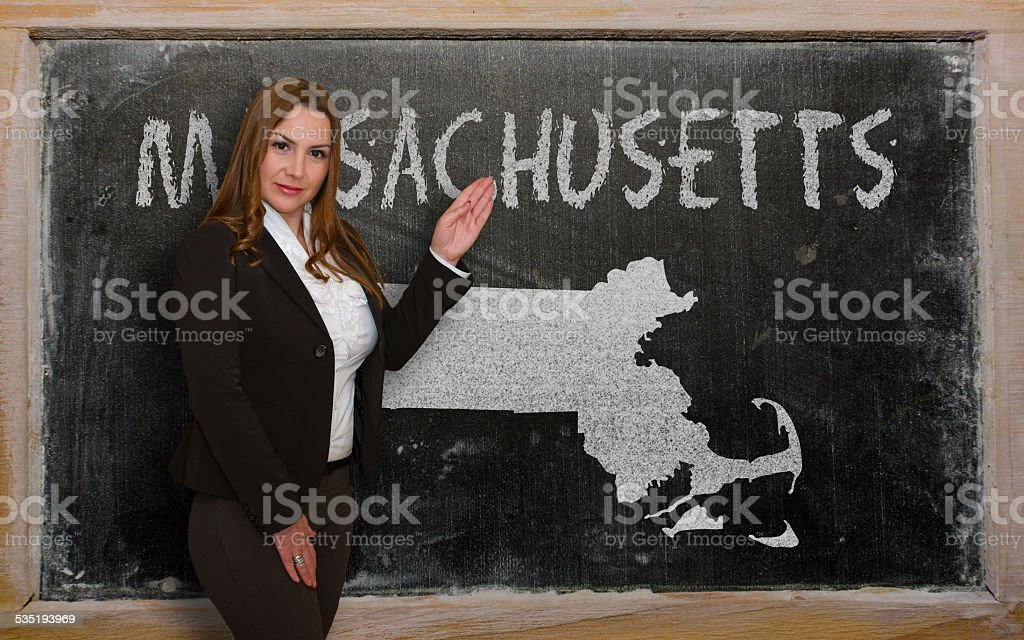 Teacher showing map of massachusetts on blackboard stock photo