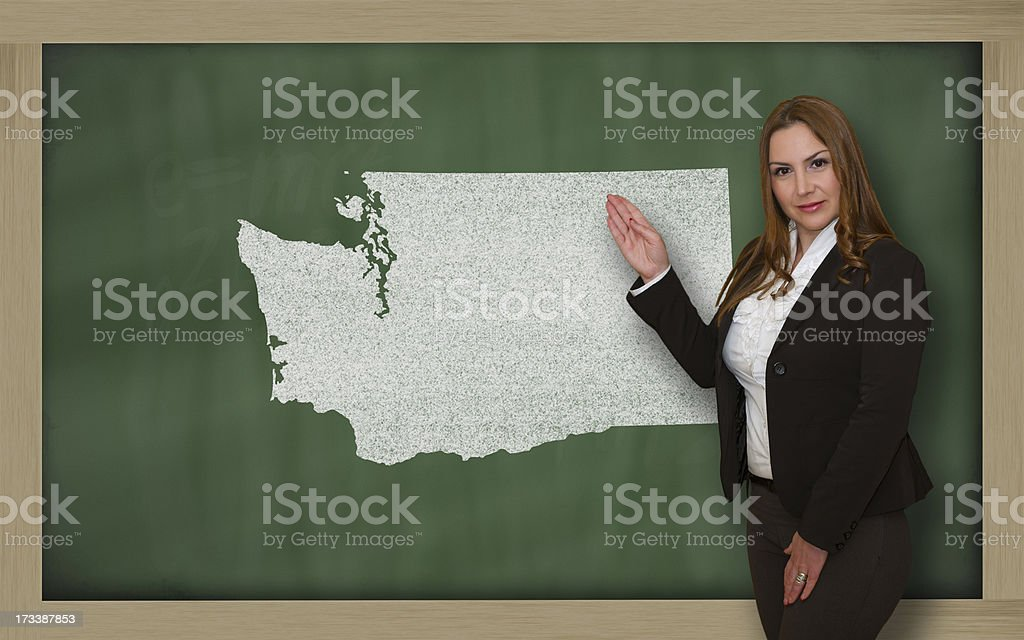 Teacher showing map of washington on blackboard royalty-free stock photo
