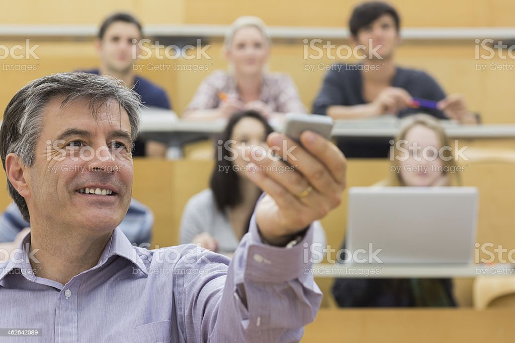 Teacher showing something to the class stock photo
