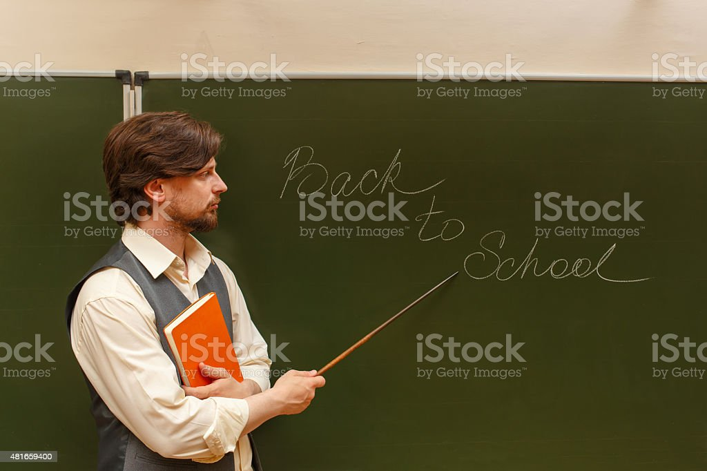 Teacher shows pointer on back to school. stock photo