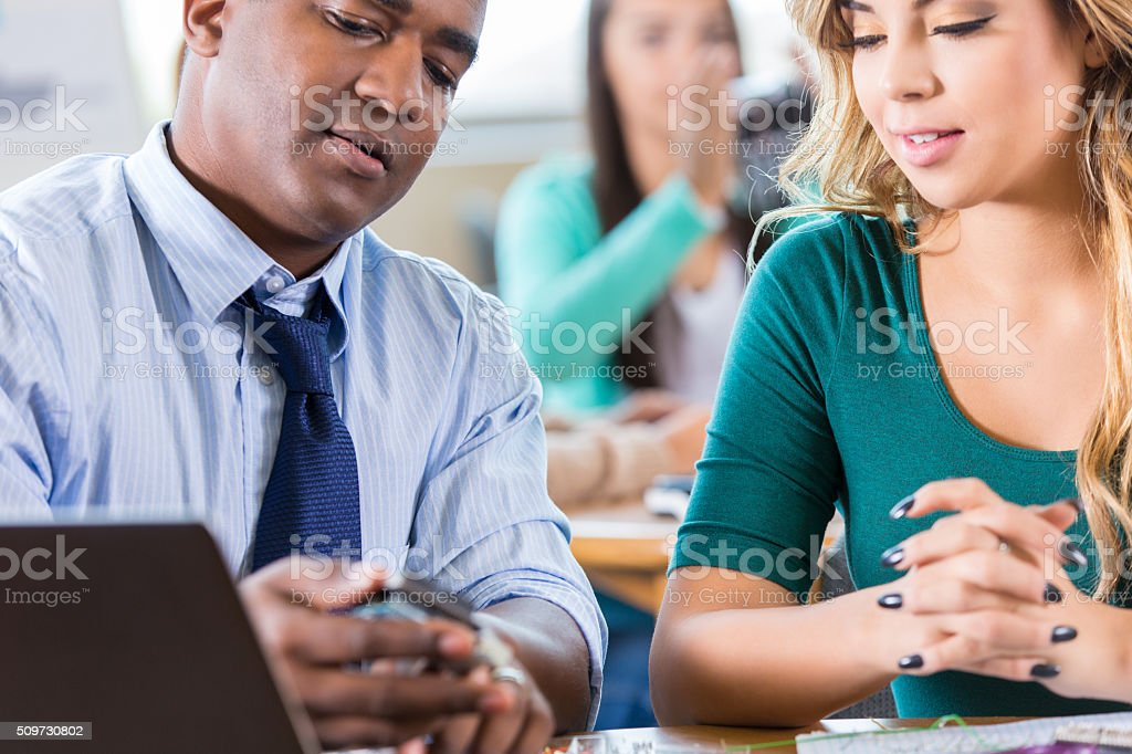 Teacher shows student component in class at STEM high school stock photo