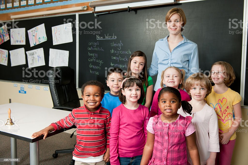 Teacher Standing with Her Students stock photo