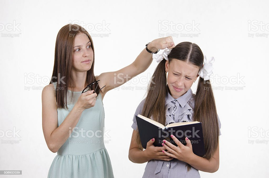 Teacher student knocks on the head stock photo