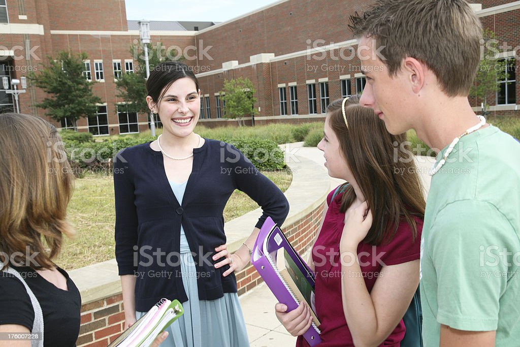 Teacher Talking With Her Students in the School Courtyard royalty-free stock photo