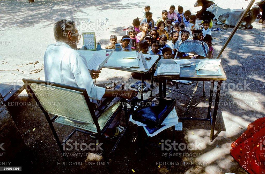 teacher teaches children in the outdoor classroom stock photo