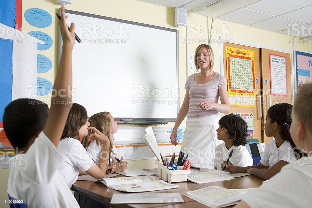 Teacher teaching a junior school class stock photo