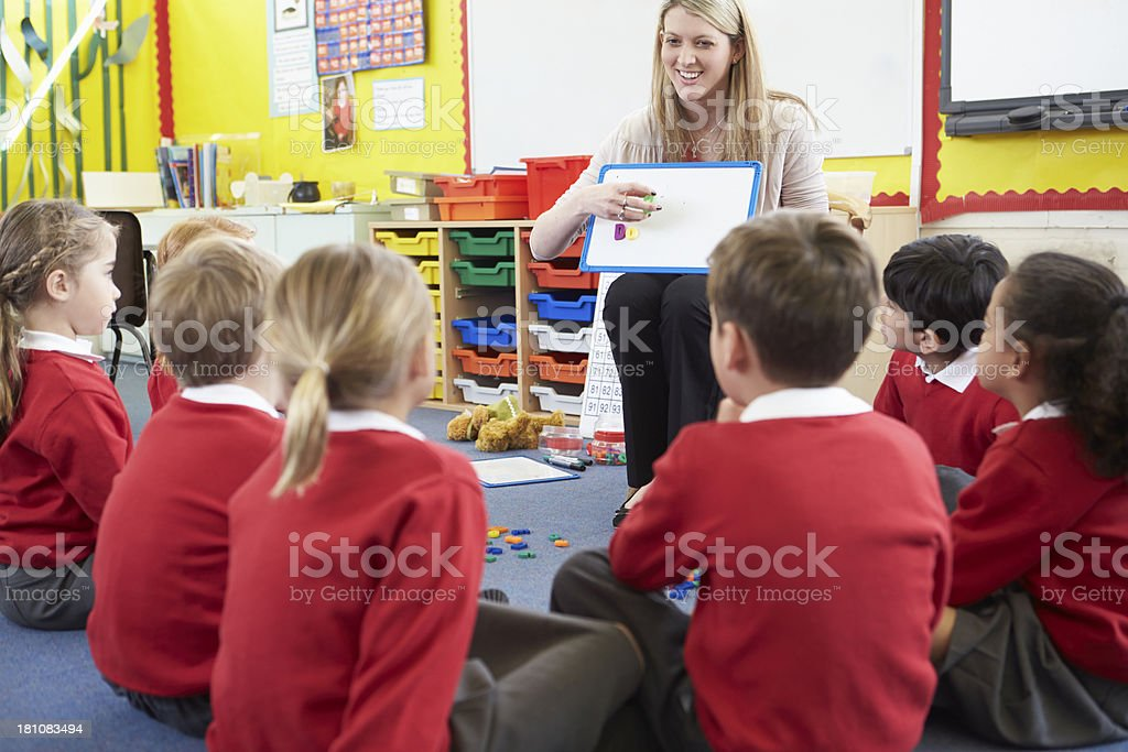 Teacher teaching elementary school students royalty-free stock photo
