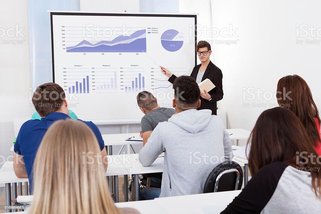 Teacher Teaching Graphs To College Students stock photo