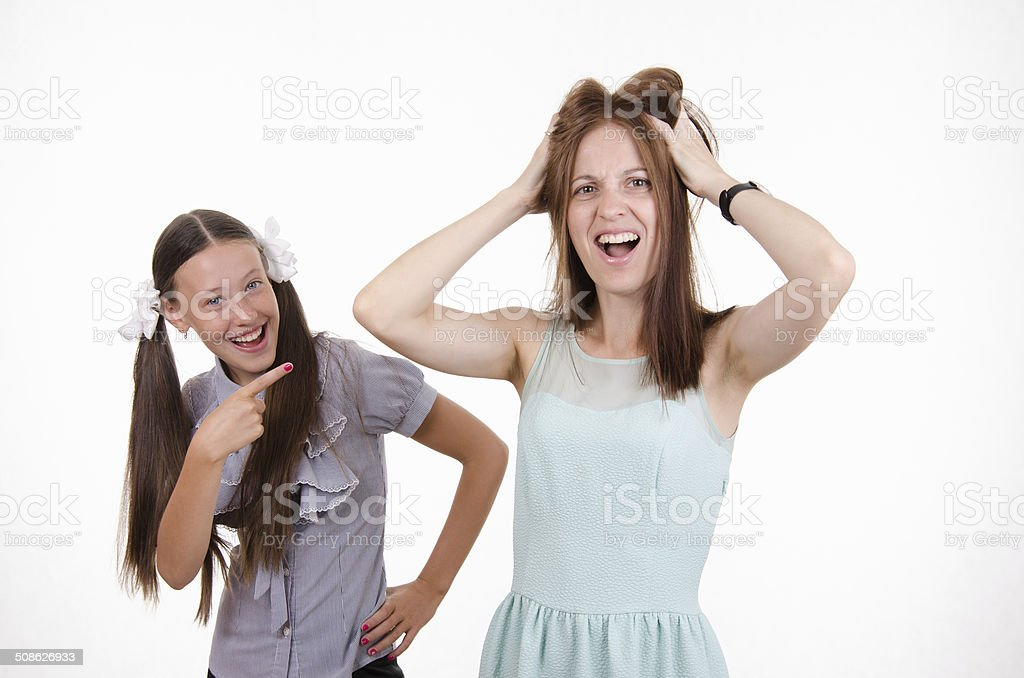 Teacher tearing my hair out from the pupil stock photo