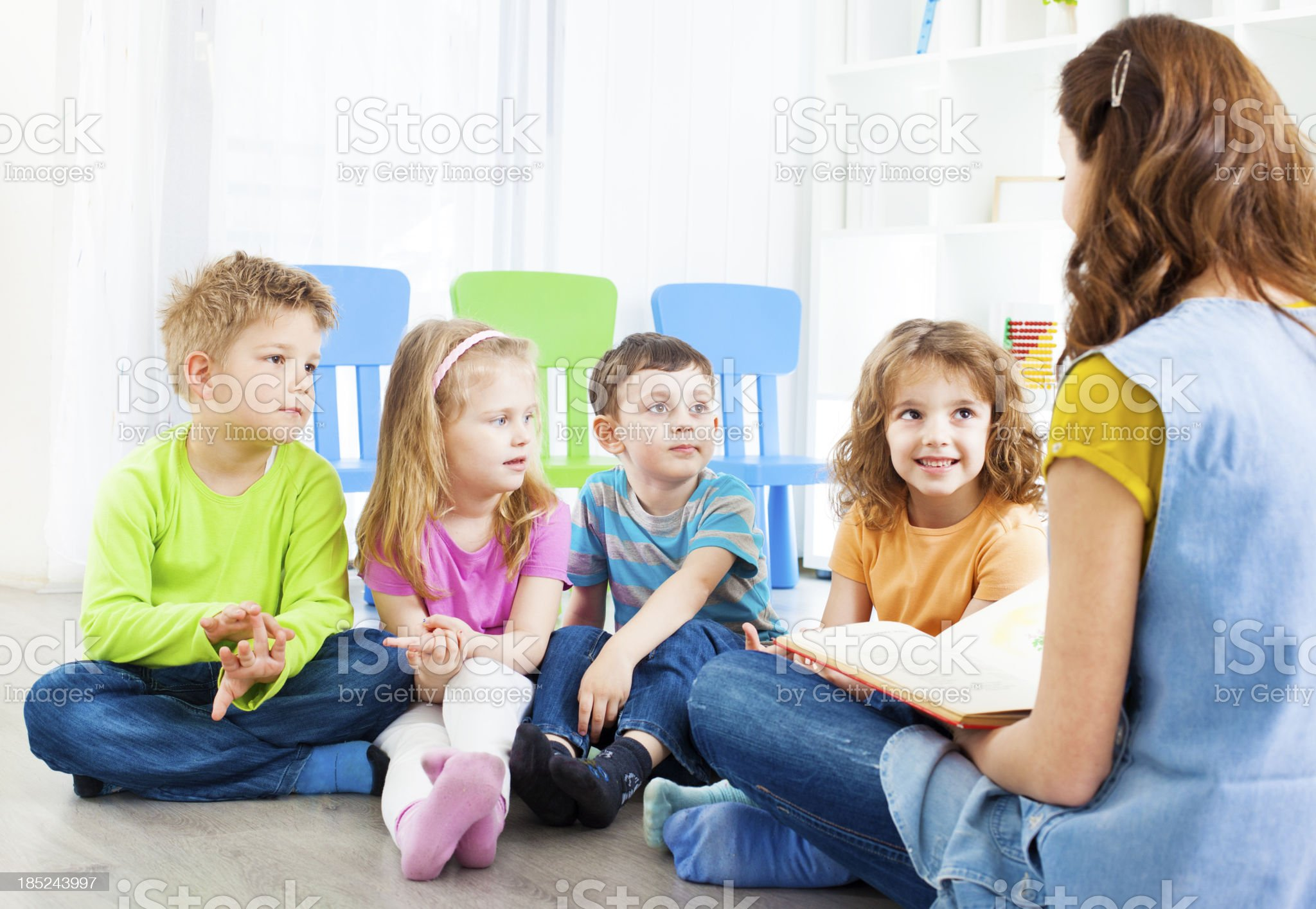 Teacher Telling A Story to children. royalty-free stock photo