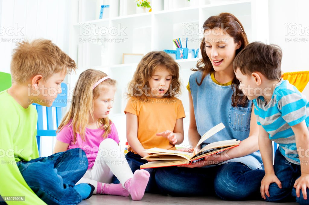 Teacher Telling A Story to children. stock photo