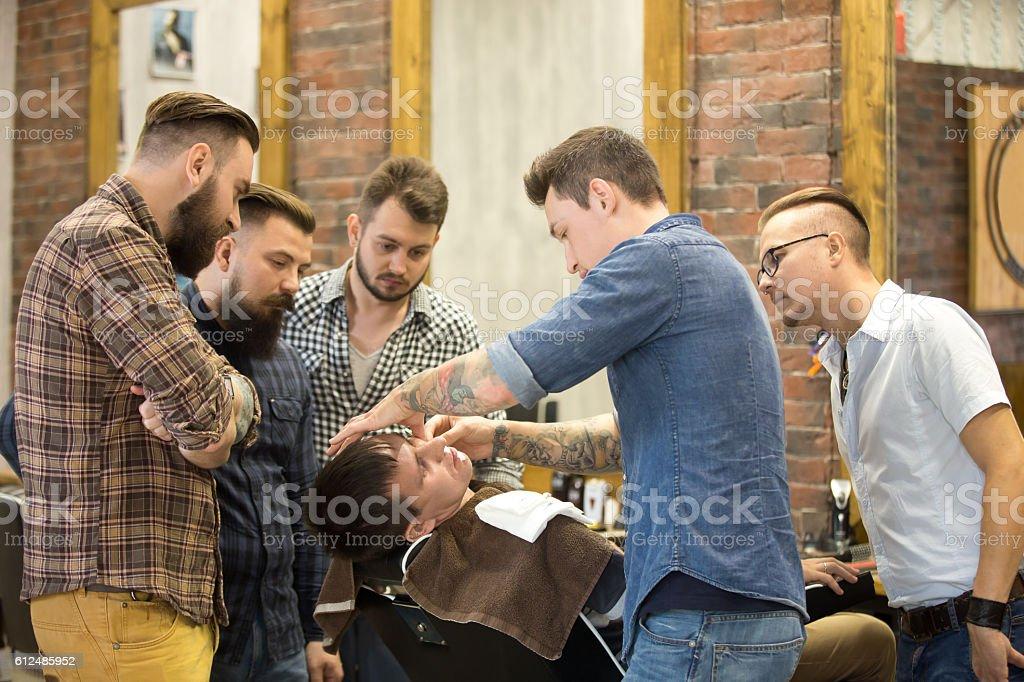 Teacher training students in beard shaving stock photo
