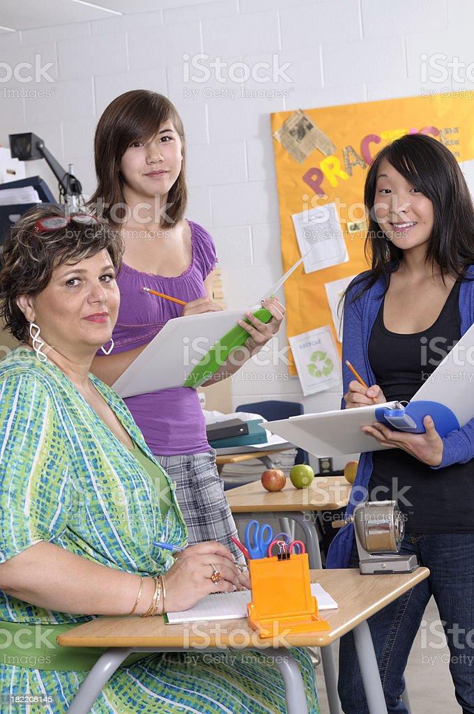 Teacher tutoring students royalty-free stock photo