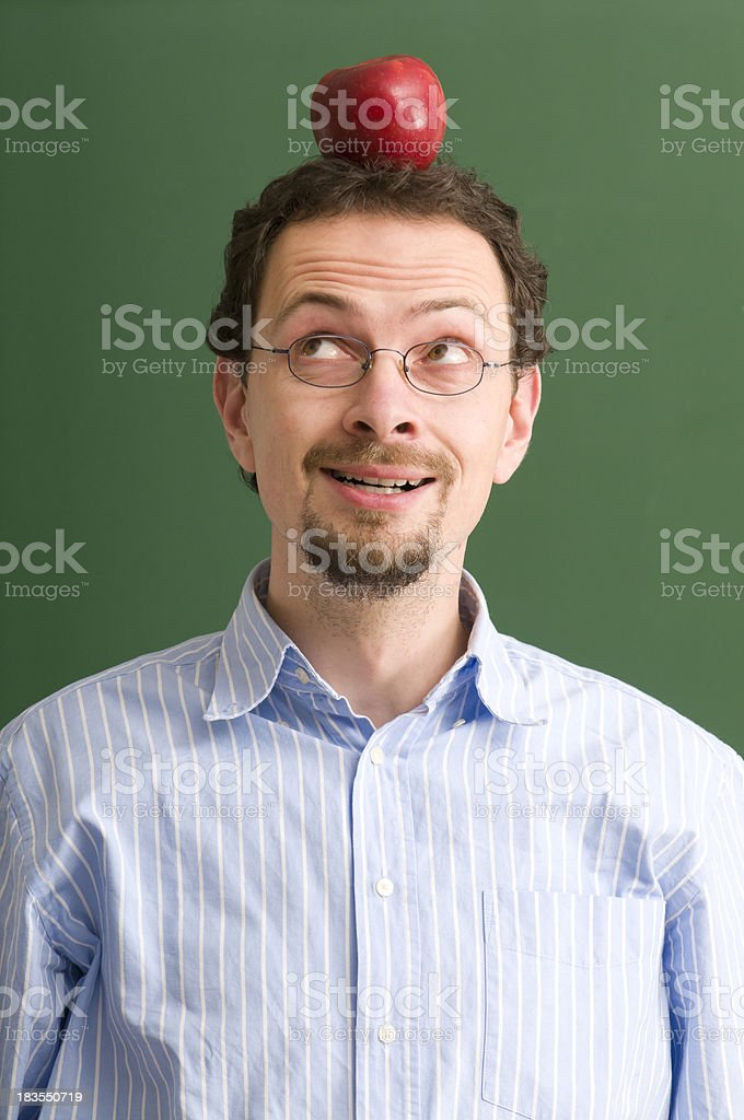 teacher with apple on his head royalty-free stock photo
