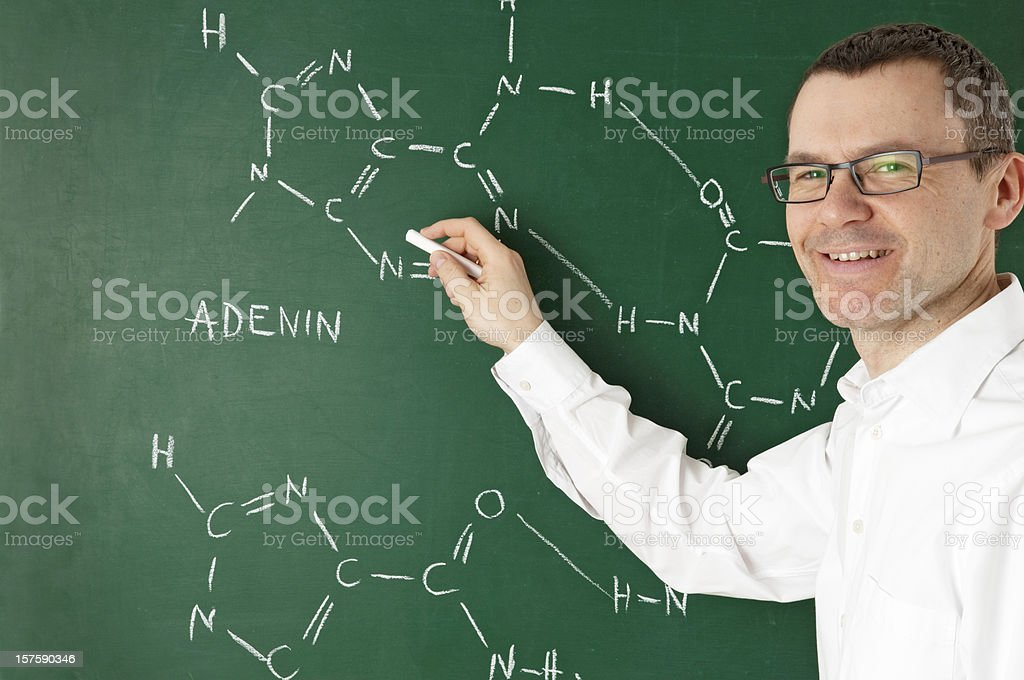 teacher with blackboard stock photo