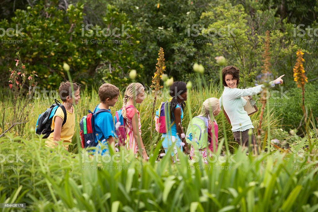 Teacher With Children On Field Trip stock photo