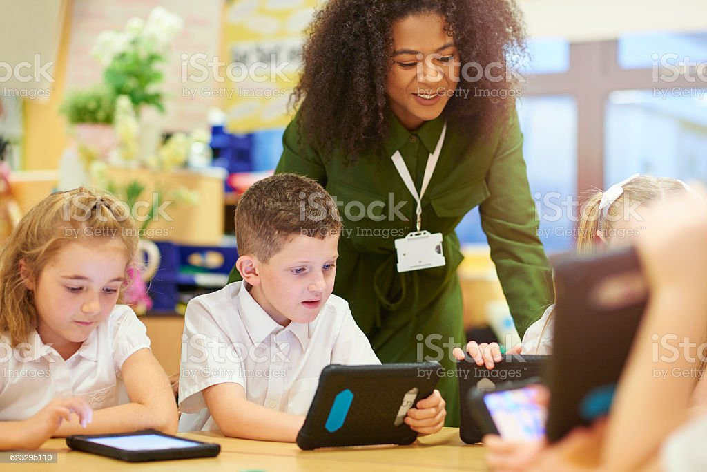 teacher with digital ready students stock photo