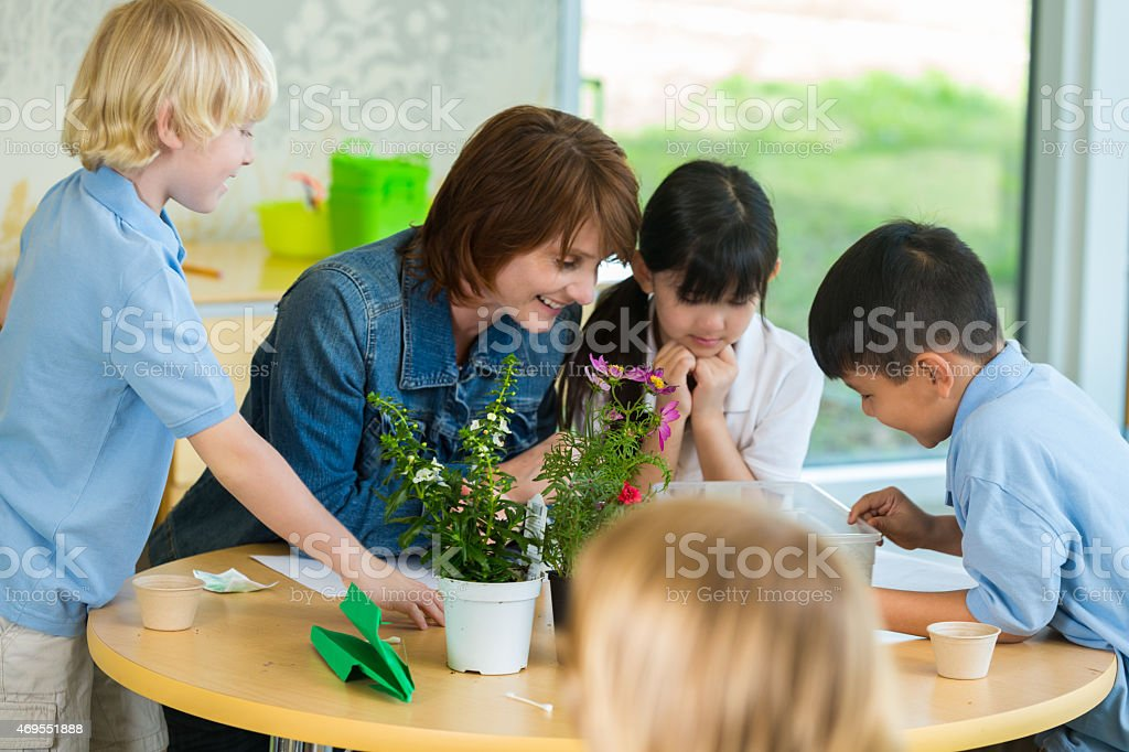 Teacher with elementary studets in earth science class stock photo