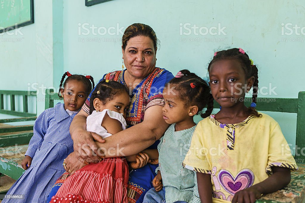 Teacher with goup of children in Southern Egypt royalty-free stock photo
