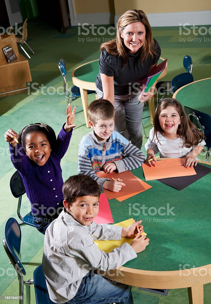 Teacher with group of children in art class stock photo