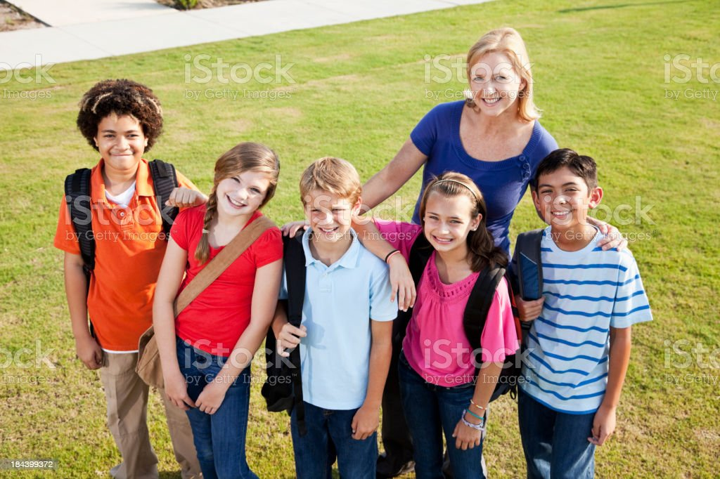 Teacher with  group of students outdoors royalty-free stock photo