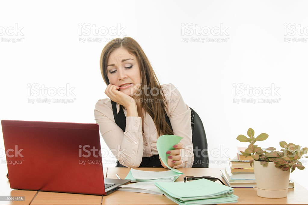 Teacher with horror looks in a notebook student stock photo