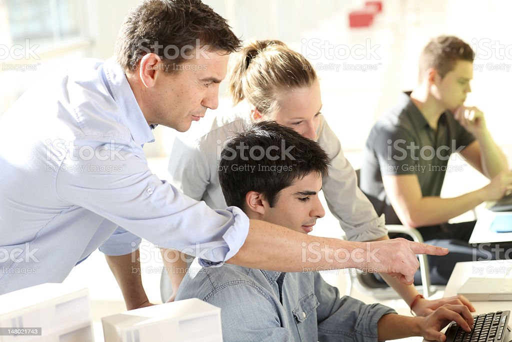 Teacher with students in training class stock photo