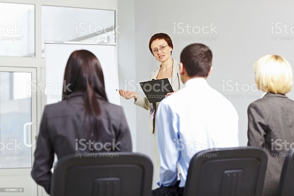 Teacher with students on seminar royalty-free stock photo