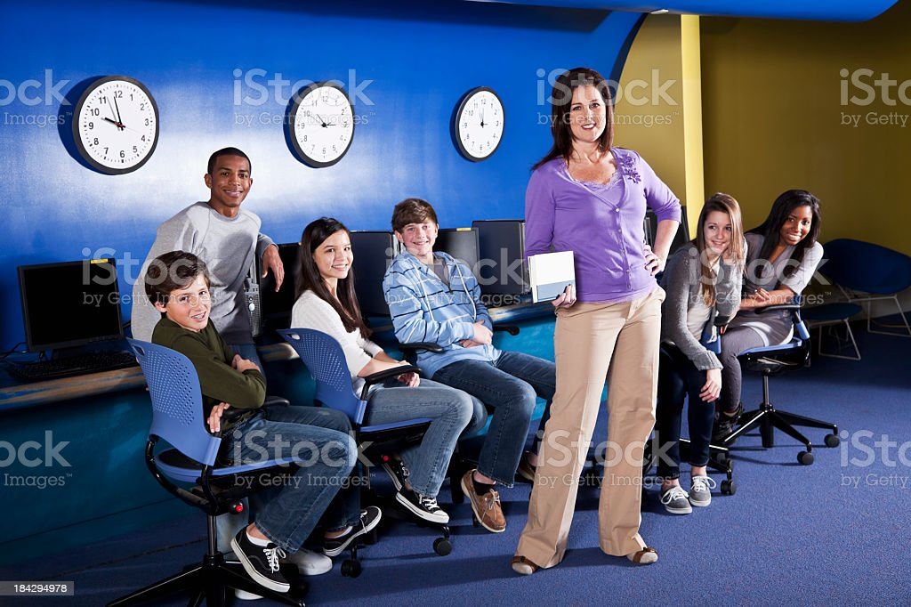 Teacher with teenage students royalty-free stock photo