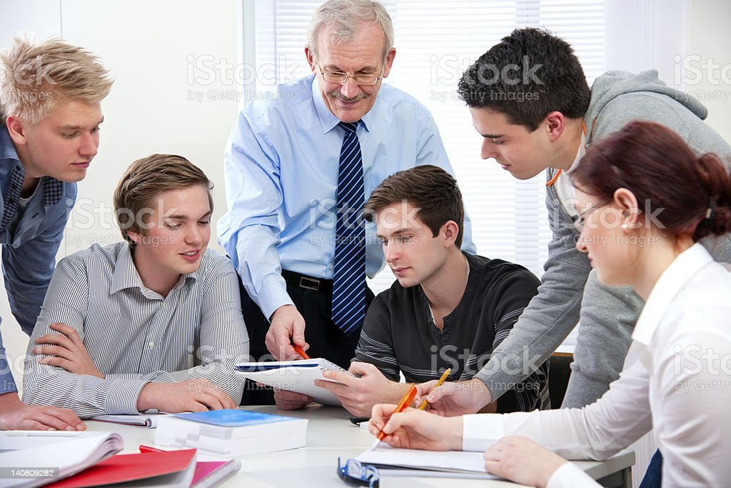 teacher with the high school students royalty-free stock photo