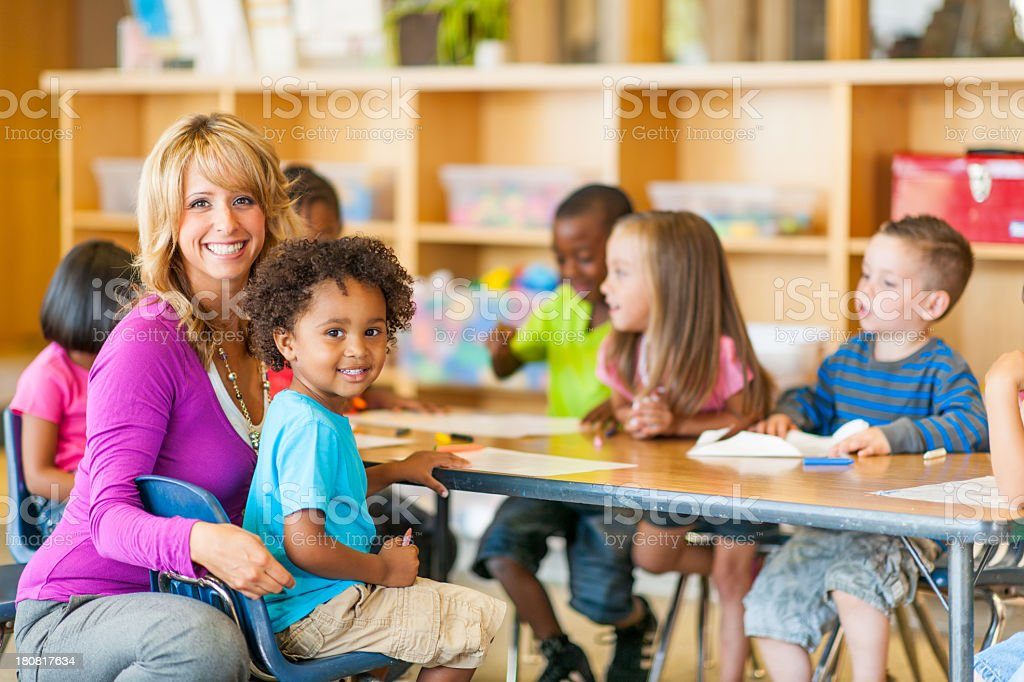 Teacher with young children in a classroom royalty-free stock photo
