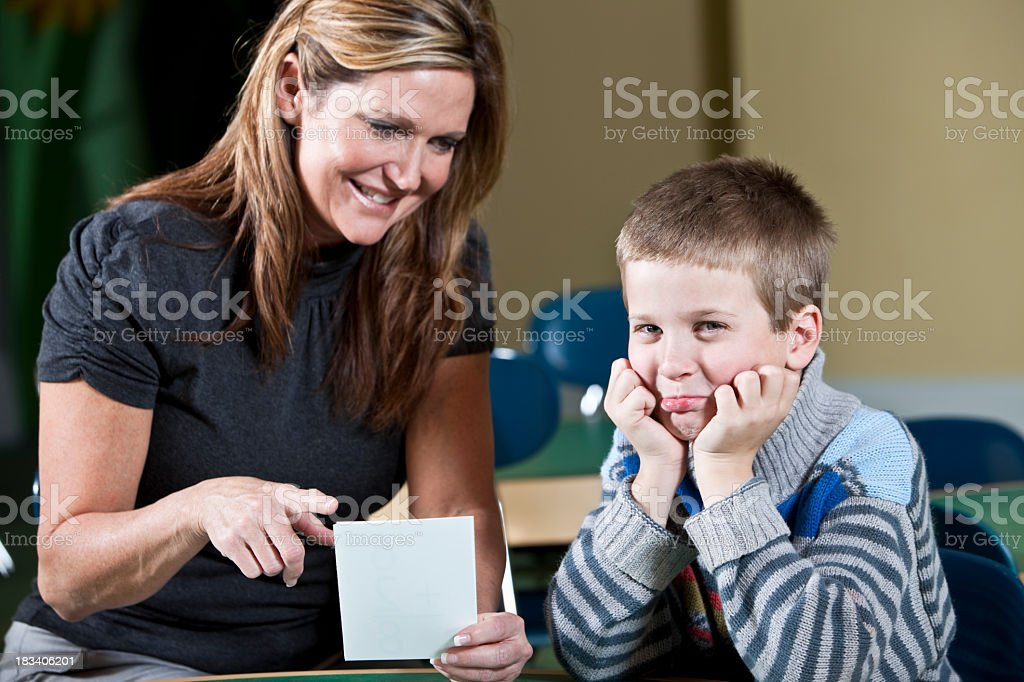 Teacher with young student, making pretend frown stock photo