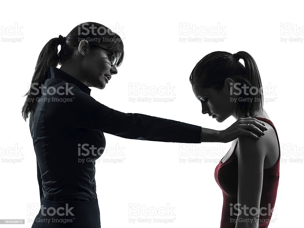 teacher woman mother teenager girl consoling discussion in silhouette royalty-free stock photo