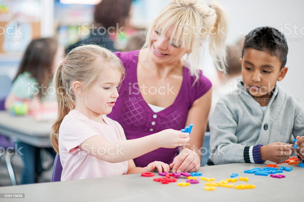Teacher Working with the Students stock photo