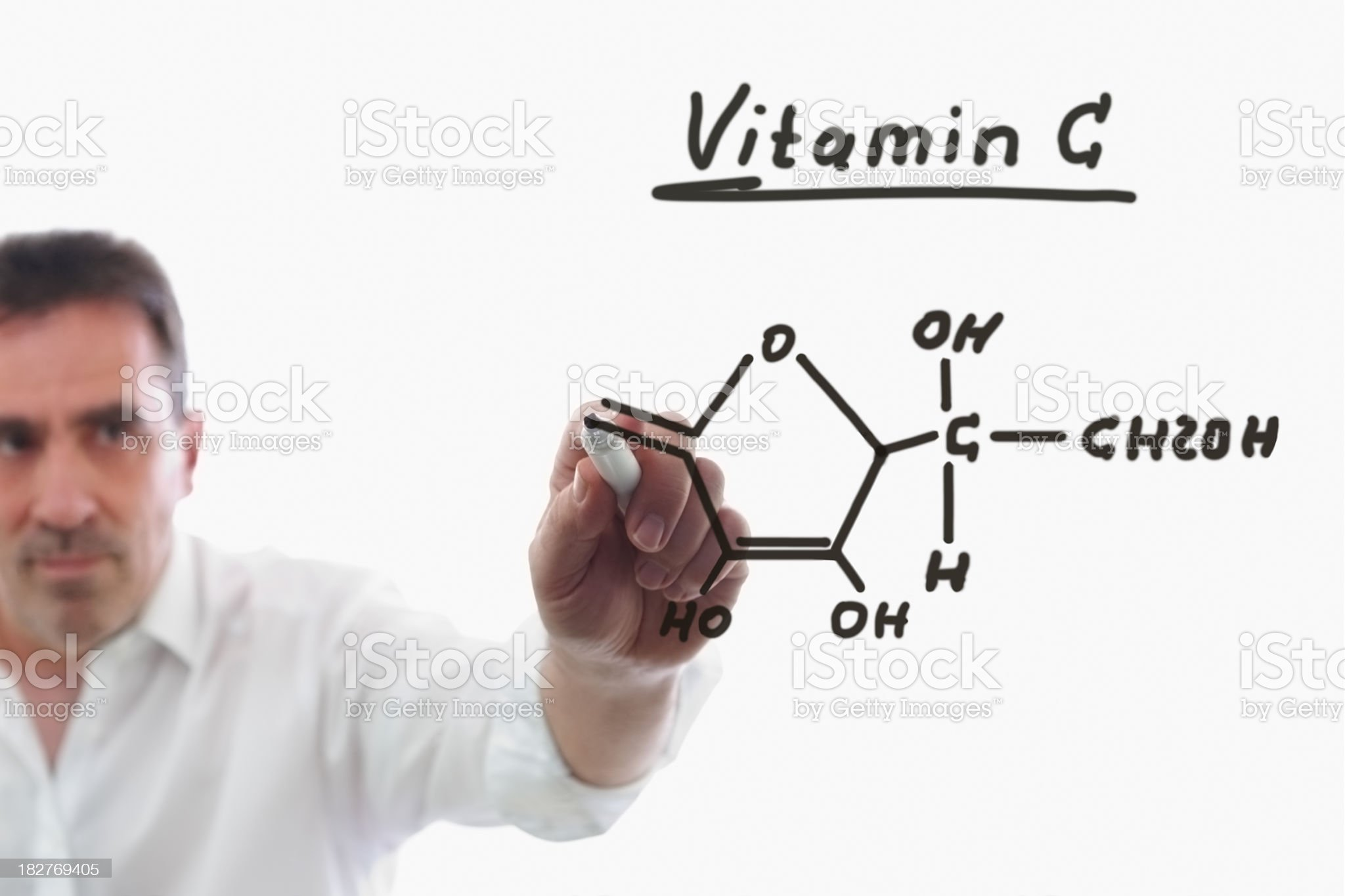 Teacher writes chemical formula royalty-free stock photo