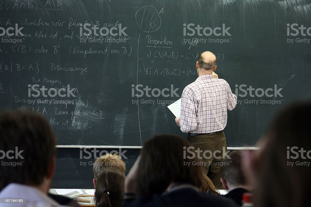 Teacher writing on the board for math royalty-free stock photo