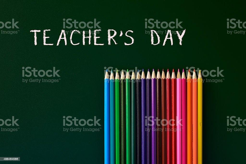 teachers day written in a green chalkboard stock photo